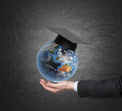 Student holding earth Stock Image