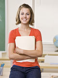 Student holding file folder Stock Photo