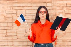 Free Student Holding Flag And Book Learning Foreign Language Stock Images - 128228204