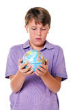Student holding a globe isolated Royalty Free Stock Photography