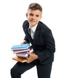 Student holding heavy books. Isolated Royalty Free Stock Photography