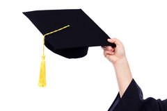 Student holding her graduation cap Royalty Free Stock Images