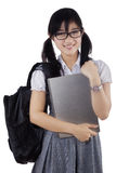 Student holding laptop in studio Royalty Free Stock Photo