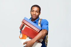 Student Holding Notebooks - Horizontal. Male student wearing a backpack carries notebooks and boxes.  Horizontally framed photograph Stock Photography