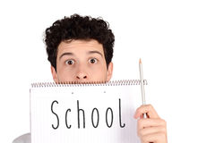 Student holding pencil and notebook with text Stock Images