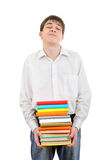 Student Holding Pile of the Books. Student stand with Many Books Isolated on the White Background Stock Images