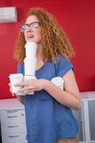 Student holding pile of coffee cup Royalty Free Stock Images