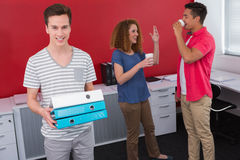 Student holding pile of ring binder near classmates with coffee Royalty Free Stock Photos