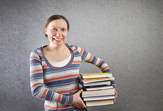 Student holding stack of books. Stock Photography