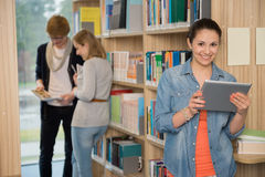 Student holding tablet in library Stock Photography