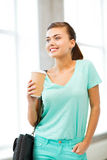 Student holding take away coffee cup Royalty Free Stock Photos