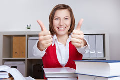 Student holding thumbs up while Stock Photos