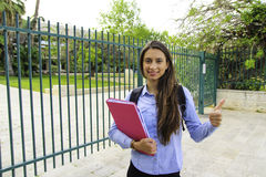A student holds a binder ,Smiling hold a books royalty free stock photos