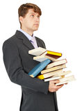 Student holds a lot of books Royalty Free Stock Photo