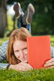 Student Holds a Red Book Stock Photo