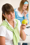 Student at home - happy woman with apple Stock Photo