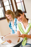 Student at home - two happy woman with laptop Royalty Free Stock Image
