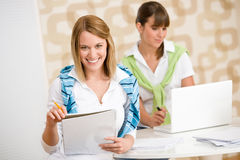 Student at home - two happy woman with laptop Stock Photos