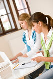 Student at home - two woman with book and laptop Royalty Free Stock Image