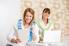 Student at home - two woman with book and laptop Royalty Free Stock Photos