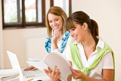 Student at home - two woman with book and laptop Stock Image