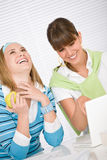 Student at home - two young woman with laptop Royalty Free Stock Photos