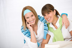 Student at home - two young woman study together Stock Photos
