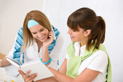 Student at home - two young woman study together Royalty Free Stock Photography