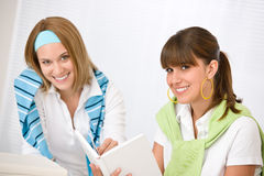 Student at home - two young woman study together Stock Photo