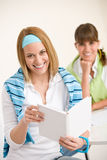 Student at home - two young woman study together Royalty Free Stock Images