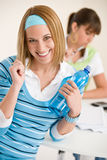 Student at home - woman with bottle of water Royalty Free Stock Photo
