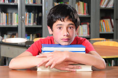 Student hugging books Stock Images