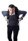 Student in a hurry. Young student with backpack in a hurry isolated on a white background Stock Photography
