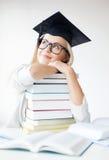 Student i avläggande av examenlock Royaltyfria Bilder