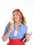 Student with ice cream. Blonde holding ice cream and a book on a white background Royalty Free Stock Photo