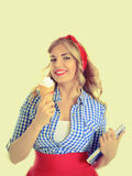 Student with ice cream. Blonde holding ice cream and a book on a white background Royalty Free Stock Images