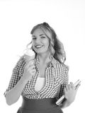 Student with ice cream. Blonde holding ice cream and a book on a white background Stock Photography