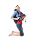 Student jumping in the air. Young teenager student with a school bag jumping in the air Royalty Free Stock Photography