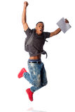 Student jumping because good grades. Handsome student jumping because of good grades, on white Royalty Free Stock Image