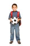 Student: Junge, der Fußball hält Stockbild