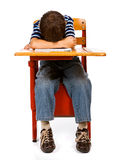 Student: Junge mit Kopf auf Schreibtisch Stockbild