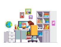 Student kid sitting at desk, doing school homework. Student kid sitting at home office desk, doing school homework, surfing web on desktop computer. Modern girls Royalty Free Stock Photo