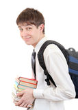 Student with Knapsack Holding the Books. Happy Student with Knapsack Holding the Books Isolated on the White Background Royalty Free Stock Photography