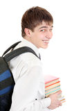 Student with Knapsack Holding the Books. Happy Student with Knapsack Holding the Books Isolated on the White Background Royalty Free Stock Photos