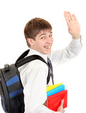 Student with Knapsack Wave Goodbye. Happy Student with Knapsack and the Books Wave Goodbye. Isolated on the White Background Royalty Free Stock Image