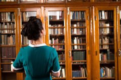 Student lady in library Stock Photography