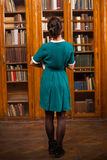 Student lady in library Royalty Free Stock Image