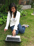 Student on a laptop. Young student working on her laptop outside Stock Images