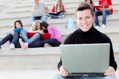 Student with laptop. Group of students with laptops study outdoors Royalty Free Stock Images