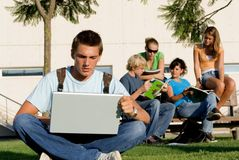 Student with laptop. Group of students with books Stock Image
